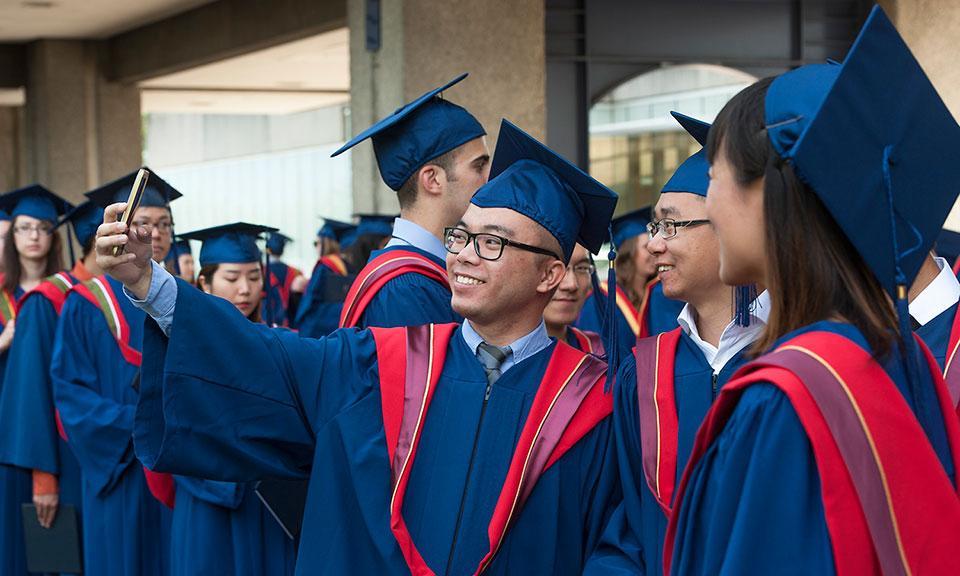 Convocating grads take selfies