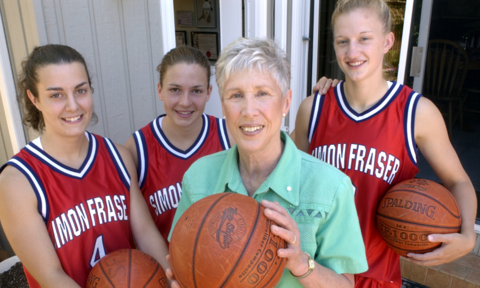 Barbara Rae with members of SFU Women's basketball team